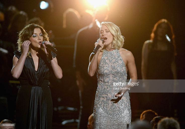 Martina McBride and Carrie Underwood perform for Dolly Parton onstage at the 50th annual CMA Awards at the Bridgestone Arena on November 2, 2016 in Nashville, Tennessee.