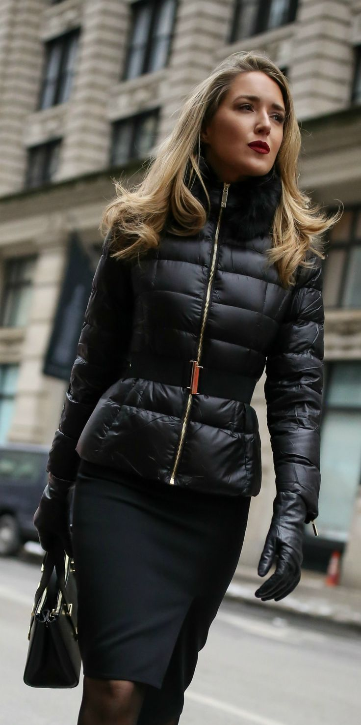39ef7d684 Fashionable Winter Workwear Style // Black quilted puffer jacket with waist  belt, black asymmetrical pencil skirt, black embellished pumps, ...