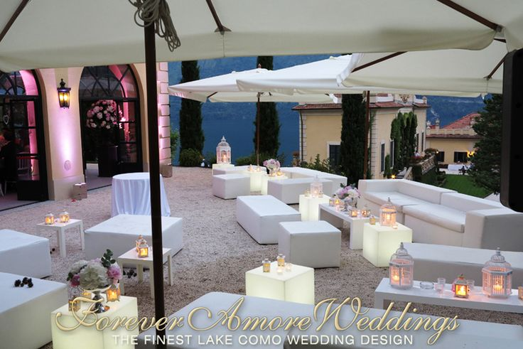 Wedding reception Villa Balbianello, Loggia Segrè Terrace, lounge area with white ecoleather sofas and luminous side tables. Picture by ForeverAmoreWeddings ©