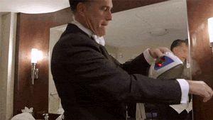Mitt Romney Irons His Shirt While Wearing It - Mitt Romney News - Esquire