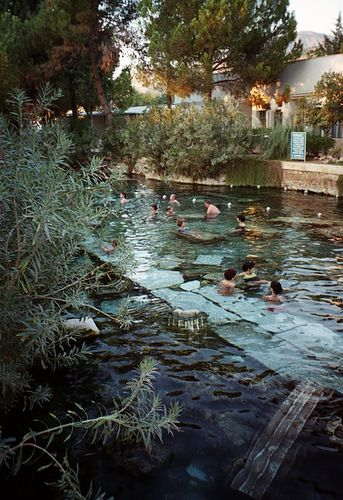 Ancient Ruins - Roman Baths Hierapolis, Turkey. Take a bath in an ancient pool, into sparkling water (yes, sparkling! and bubbles tinkle your skin), sitting on a piece of a fallen column that was standing there in times you studied in your history books.