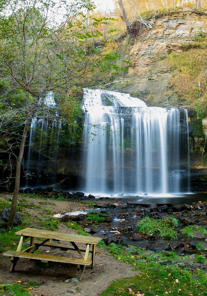 picnic at waterfall Perhaps the best perk of this hike is the sheltered cove to the left of the large waterfall sign just before you reach the observation spur trail it's a shady picnic spot like no other access the lewis falls trailhead near mile marker 52, just south of the byrd visitor center.