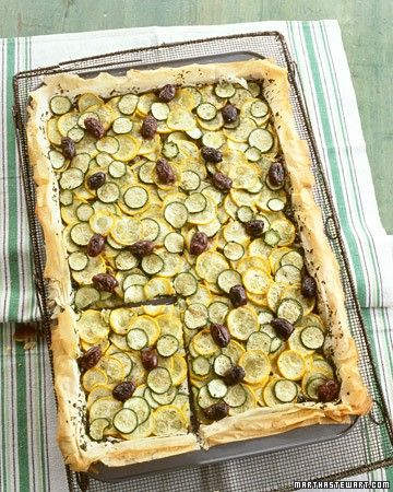 Vibrant slices of zucchini and yellow squash, plus Greek olives, are arranged over flaky store-bought phyllo dough for an easy seasonal tart.
