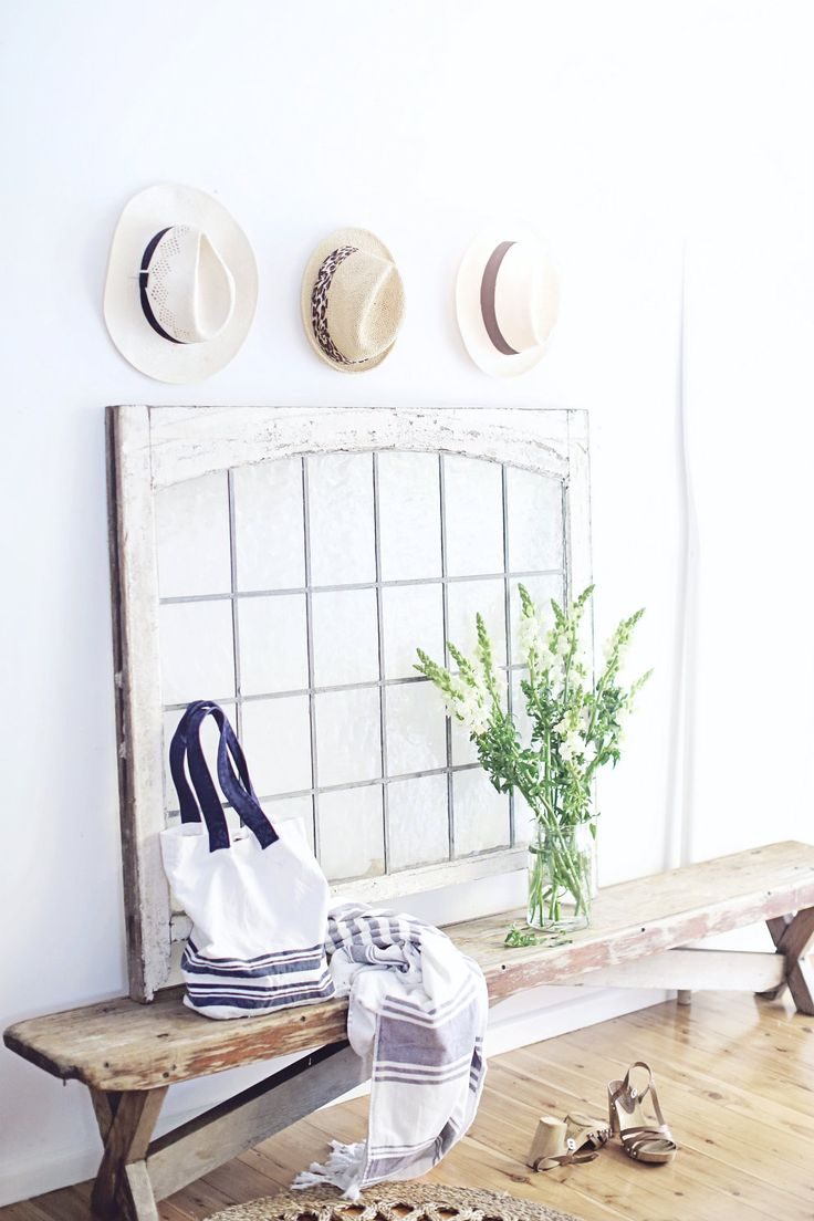 from a beach cottage, coastal style old vintage headlight window, rustic bench, jute rug, white