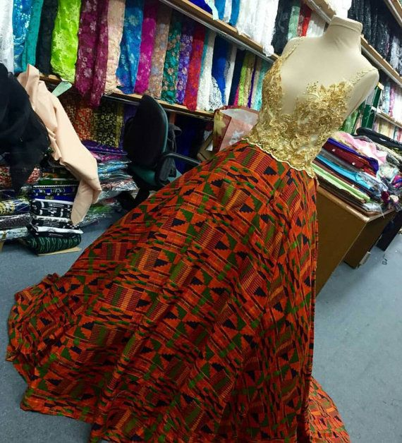Check out this item in my Etsy shop https://www.etsy.com/uk/listing/253545281/kente-dashiki-african-wedding-gown