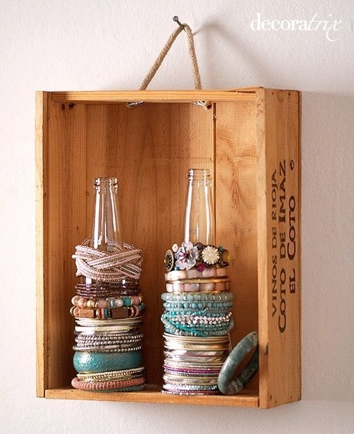 Love this idea for using glass bottles to store bracelets. A bud vase or paper towel holder would also work well.