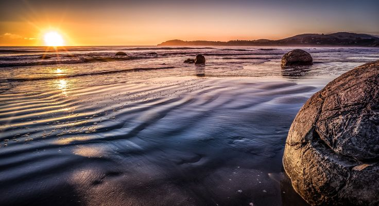 - O r i g i n s - - Moeraki Boulders, New Zealand..I just love waking up with the sun...not much beats greeting the sun with camera in hand.