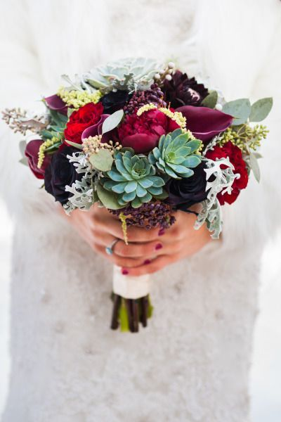 A winter bouquet with pretty succulents: http://www.stylemepretty.com/utah-weddings/park-city/2014/12/22/snowy-mountain-winter-wedding/ | Photography: Cory Ryan - http://www.coryryan.com/