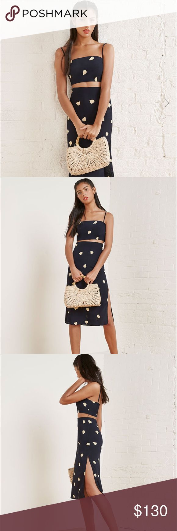 Reformation Ace Two Piece Better together. This is a two piece set with a cropped top and a slim fitting, straight skirt. - Adjustable straps- Hits below knee- Slim fit skirt- Straight neck- Very cropped Reformation Dresses Midi