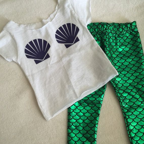 Your little mermaid will look oh so cute in my Mermaid Shell Top! Goes perfectly with my Emerald Green Mermaid scale leggings! This Tee is