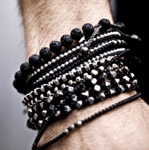 STYLE TIP: Another way of stacking bracelets is by sticking with the same hue. In this case he is wearing all black and silver. ---> FOLLOW US ON PINTEREST for Style Tips, Men's Basics, Men's Essentials on anything, OUR SALES etc... ~ VujuWear