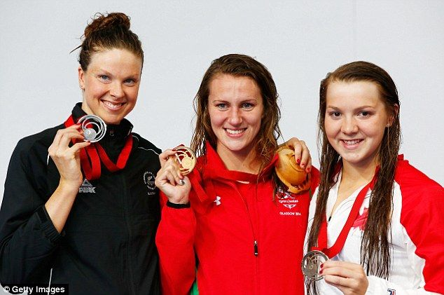 All smiles: Gold medallist Jazz Carlin (centre) poses with runner-up Lauren Boyle (left) and third-placed Brittany Maclean (right) Jazz wins first swimming gold for Wales with Commonwealth Games record in 800m freestyle final