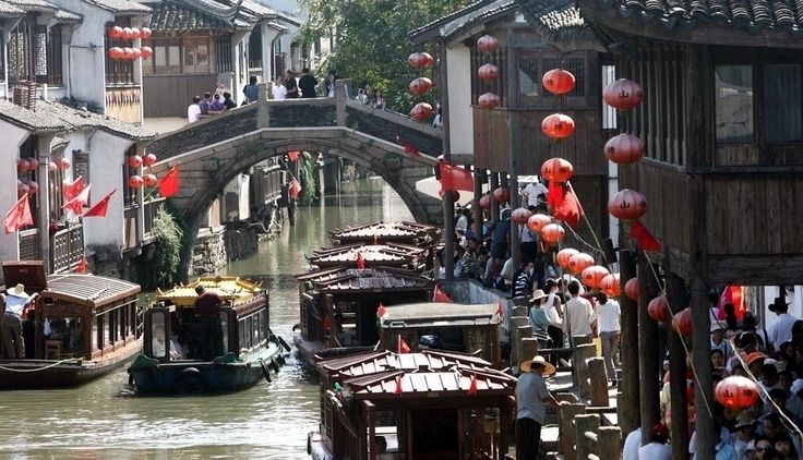 Day 15: SuZhou City, JiangSu Province, China,   SuZhou is famous for its beautiful scene, since ancient China, it is compared to heaven. Many classic buidings are seen here such   as chinese classical gardens and bridges. Soochow. Shanghai to Suzhou by train, ticket fare RMB26, 30 minutes.