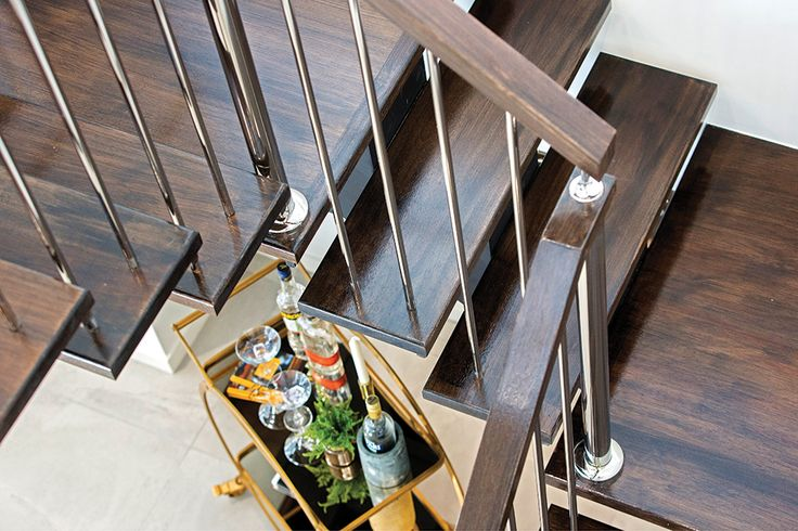 Stained staircase detail in the Hoffman display home with an Amsterdam World of Style.