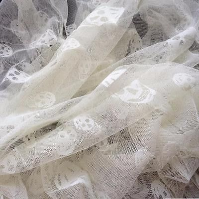 3 1/2 Yards - Floating Heads English Net Stretch Mesh Lace Skulls Ivory 58 Inch