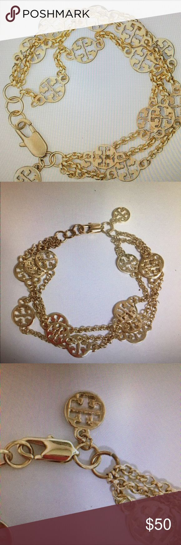Tory Burch Multi Strand Logo Bracelet Got as a gift but already owned one this beautiful shiny gold bracelet Tory Burch has the iconic logo throughout measures around 7 inches Tory Burch Jewelry Bracelets