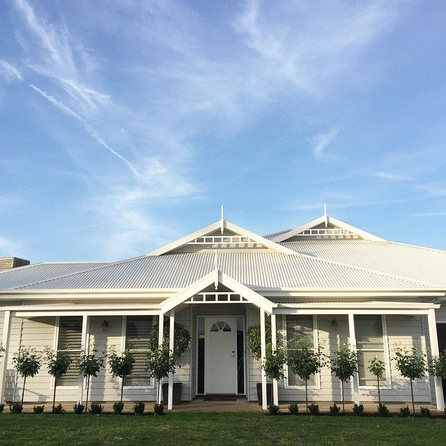 The white plantation shutters and sunscreen blinds I bought online