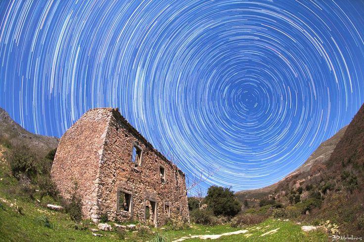 Night scenery with stellar traces above the old school of the abandoned village of Sinies, Mount Pantokrator, Corfu. Photo by: Bill Metallinos. #GreenCorfu - greencorfu.com - https://pinterest.com/greencorfu/