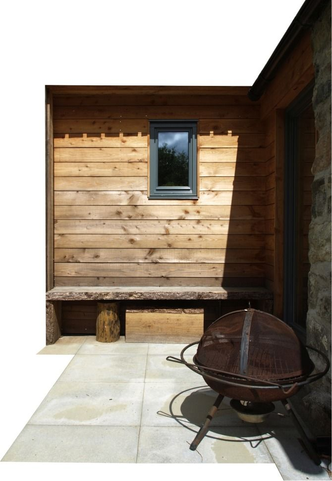 rustic seating under horizontal cladding