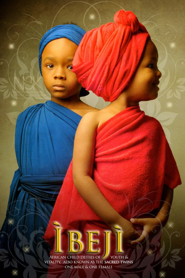 'Ibej'i (typed wrong) African child Deities of Youth and Vitality. Also known as the sacred twins, one male and one female.
