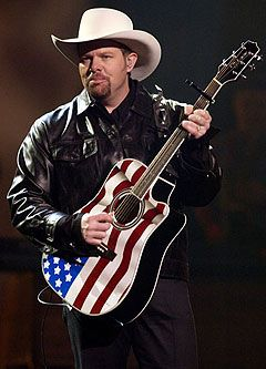 "The country singer on misconceptions about ""Red, White and Blue"" -- the patriotic song he wrote on the back of a fantasy football roster that made him come out of the Democratic closet and lose the invite from Fox News."