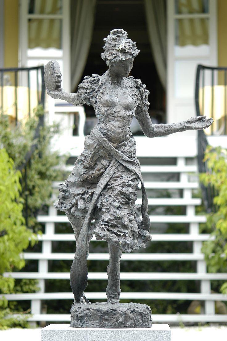 "Sculpture ""Ibsens Nora som danser tarantella"" by Nina Sundby. In our garden. Summer, spring, historic boulding, Norway. Hotel Refsnes Gods."