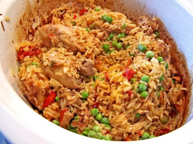 slow cooker arroz con pollo.  Add the rice for the last hour, the peas stir in the leave for 15 min after everything is done.  I may have done less broth (like 1/2)