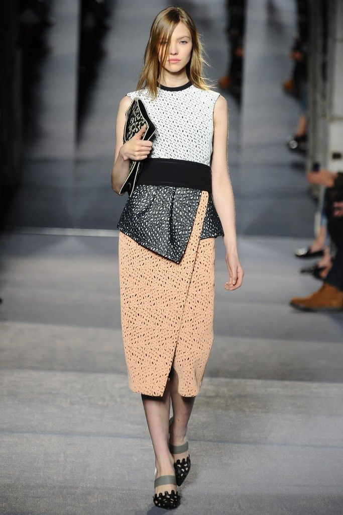 This one of the few looks that Proenza Schouler has displayed a slight hint of color in a long boucle asymmetrical skirt with a large belt and paneled detailing.  #asymmetrical #ProenzaSchouler #Fall/Winter #2013 #Fashionweek
