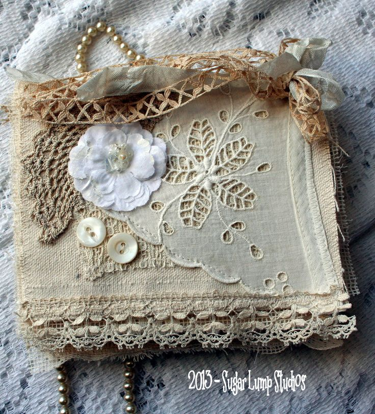 fabric book / needle case with vintage laces