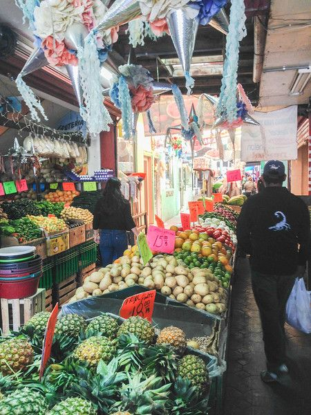 A produce vendor in Mercado Los Globos, Ensenada, Mexico