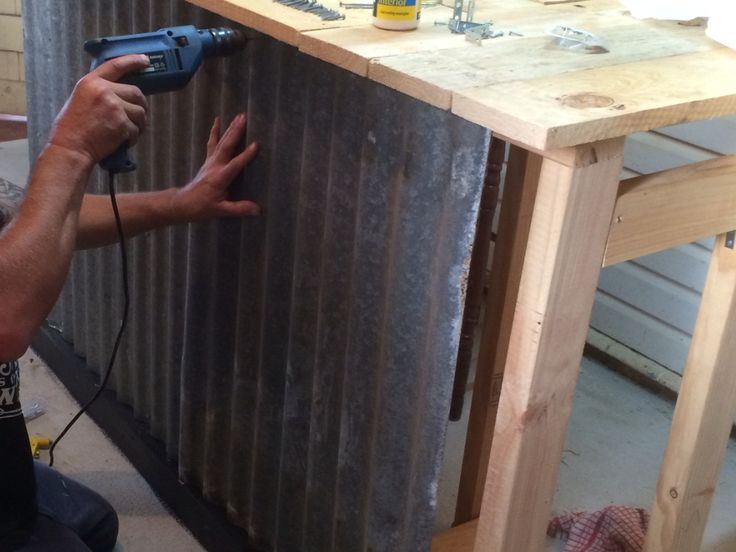 Attaching The Corrugated Iron Sheets To The Front Of The