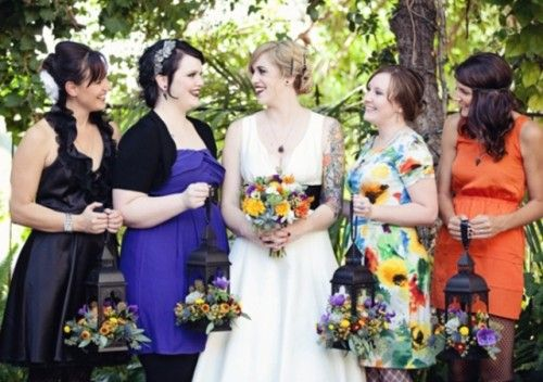 Hate the dresses but love the lantern bouquets