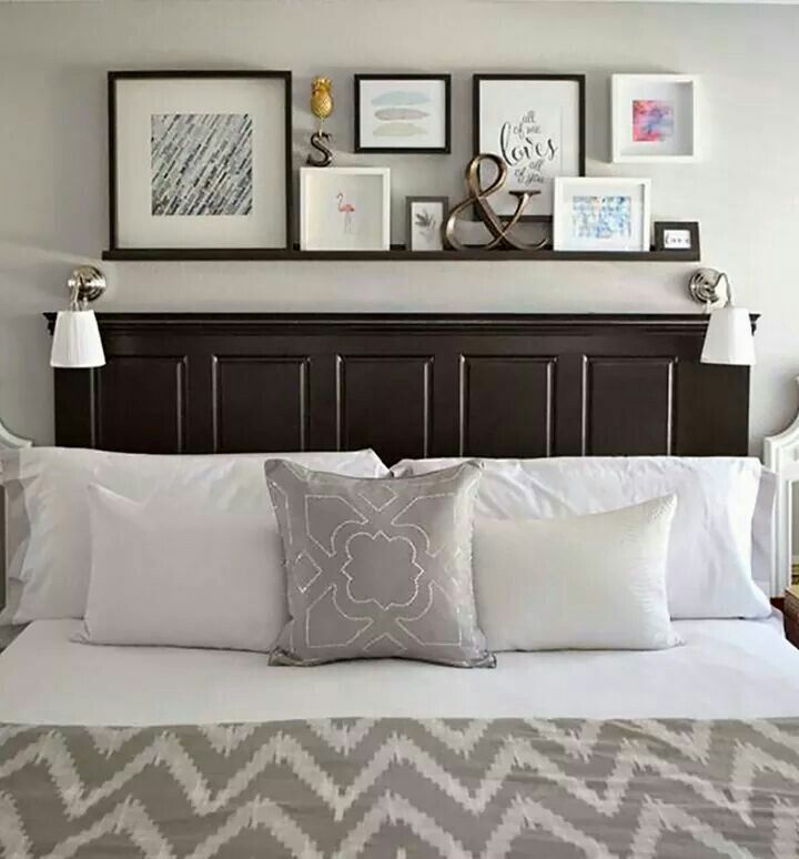Love this above bed shelf with photos :)