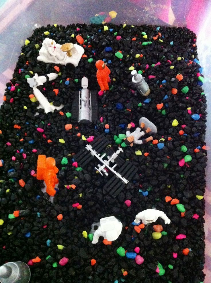 Fish tank gravel for a cute space themed sensory bin, plus other great ideas for the space theme.