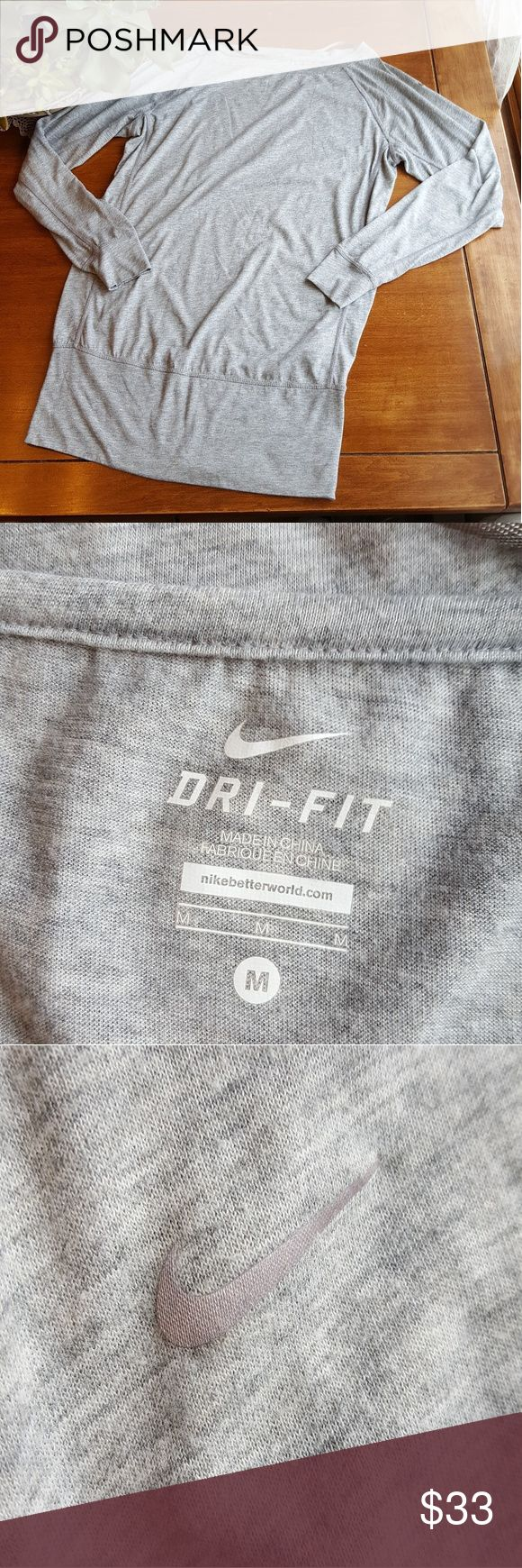 """Nike dri-fit long sleeved & torso lounging top In great used condition,  Nike grey slouchy, long (30.5 """" from shoulder to hem) soft dri-fit top. Wide cuffs on sleeves and hem. Nike Tops Tees - Long Sleeve"""