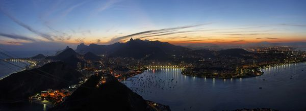 Rio de Janeiro at Dusk    Photograph by Raymond Choo, My Shot    Panoramic view of Rio de Janeiro from Pão de Açúcar (Sugar Loaf mountain) at dusk. This panorama was stitched from several sequential shots using PTGui software.