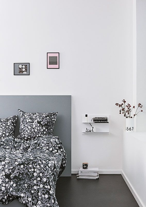 Blooming bedroom with bed linen and bed cover in Flowers by AJ design. Add a white Paper Shelf size A2 as bedside table for notebooks and other essentials.