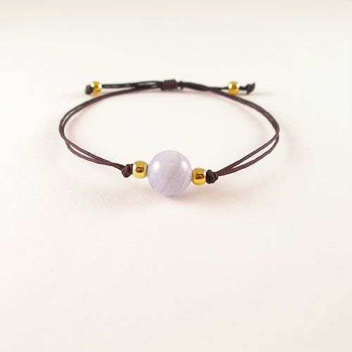 Trendy Bracelet made of a natural Chalcedony. The Thread is hand knotted into a sliding knot. The ends of the threads are knotted with goldplated (gold on 925 silver) beads.