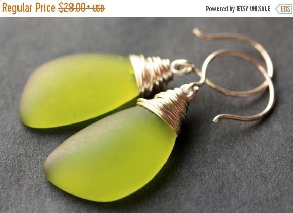 HOLIDAY SALE Olive Green Seaglass Earrings. Olive Green Earrings. Olive Green Sea Glass Earrings. Wire Wrapped Wing Earrings. Handmade Jewel by TheTeardropShop from The Teardrop Shop. Find it now at http://ift.tt/2jd3FLt!