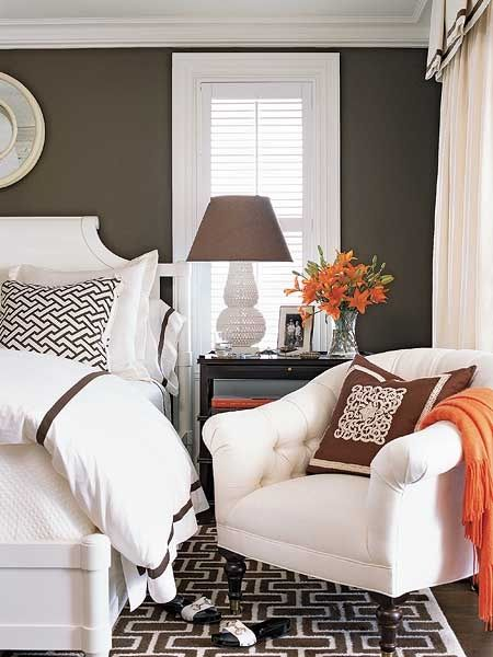 My Bedroom color idea... - In this guest bedroom, bold brown-and-white geometric prints unify the space. Bright, white fabrics as bed linens, curtains, and chair upholstery lighten up the dark brown wall paint. Accent the space with bold geometric throw pillows and a fun colored blanket.