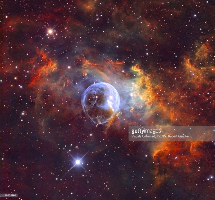 The strange symmetrically round nebula is the outcome of the prodigious energy output and fierce stellar winds of an unusually powerful star known as a Wolf-Rayet Star. The peculiar shape of the Bubble nebula marks the leading edge of the Wolf-Rayet wind front as it plows into the denser stationary material of the interstellar medium.