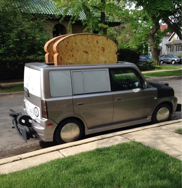 STRANGE TRUCKS - WHO SAYS YOUR BOXY SPORT VAN LOOKS LIKE A ROLLING TOASTER - THIS ONE HAS BREAD SLICES STICKING UP!