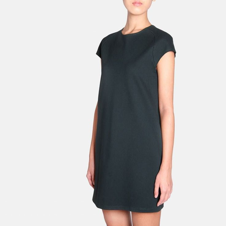 Forest  a colour that has the appeal of black but with a contemporary softness.  This cupped sleeved drink dress with streamlined hourglass silhouette is also available in dark grey and white #harlanholden by harlanholden