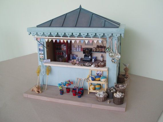 From Tinytown Miniatures. They have lots of beach items in their etsy store.