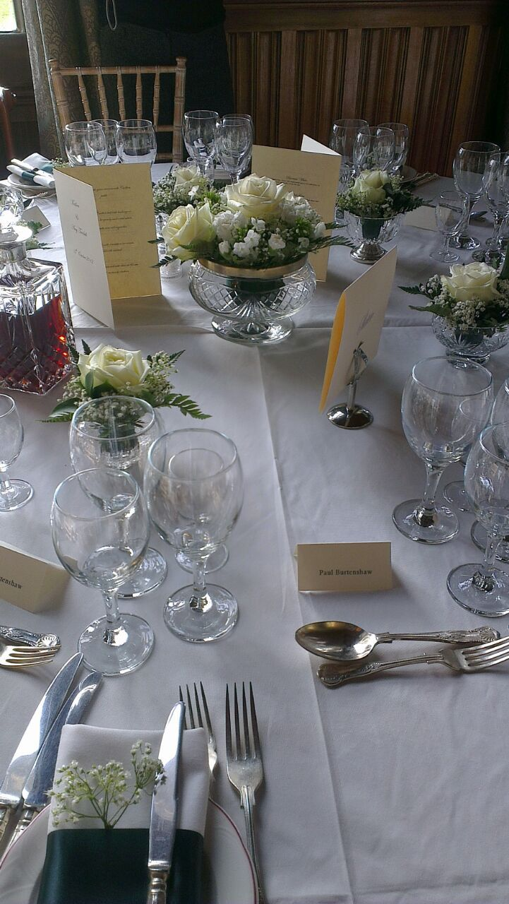 Classic table-Crystal posy bowls, crystal decanters, and a satin napkin wrap with gyp favour.-Carlton Towers.