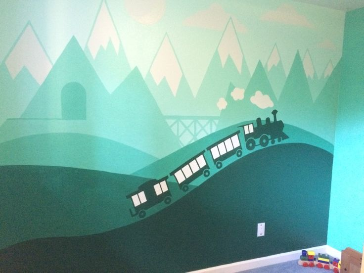 I painted this train mural for my son's bedroom. He's really in to trains and I wanted to do something that will last beyond the Thomas phase.  I painted this all by hand, I didn't use any tape. I created the image in Illustrator, and then projected my illustrator file onto his wall and traced it. Then it was just a matter of a steady hand and using a variety of bushes and rollers.