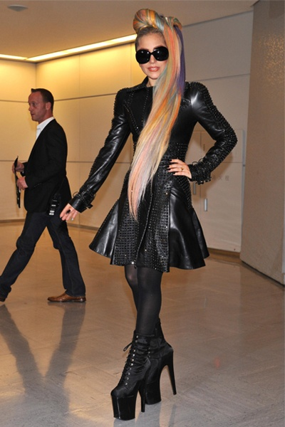 Lady Gaga in Versace. Her knees needed surgery lately. She cancelled some of her concerts.  I don't think she has worn the most healthiest shoes through the years.