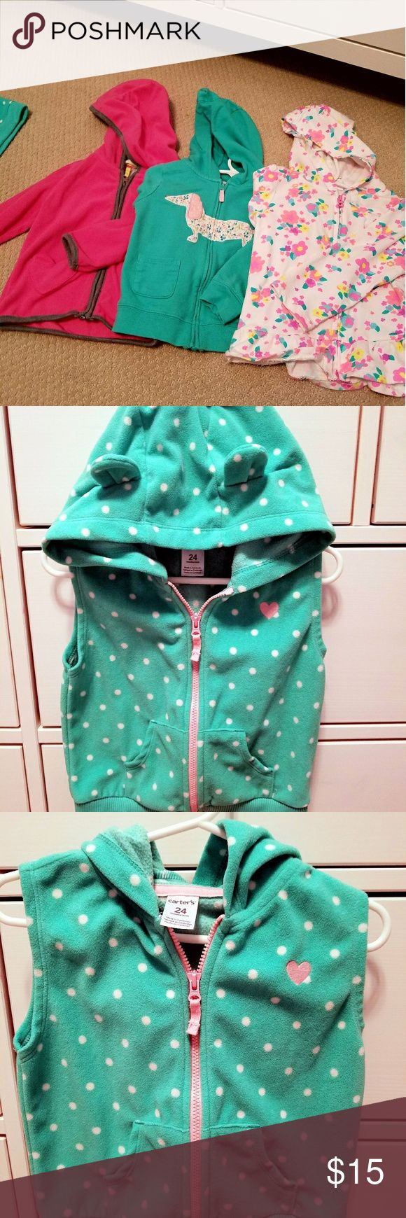 Bundle 4 items: 3 zip up hoodies & 1 zip up vest Bundle of 3 zip up hoodies and 1 zip up vest. All 24 months.  Used but in very good condition. Nice light weight jackets perfect for spring or fall.  Fleece vest by Carter's. Mint green with white polka dots. Hood has small bear ears. Cute with a light pink under shirt.  Pink fleece zip up jacket by Carter's  Green zip up jacket with pink dog made by Carter's. This is made of cotton.  Jumping Bean White with multi colored flowers. Light weight…