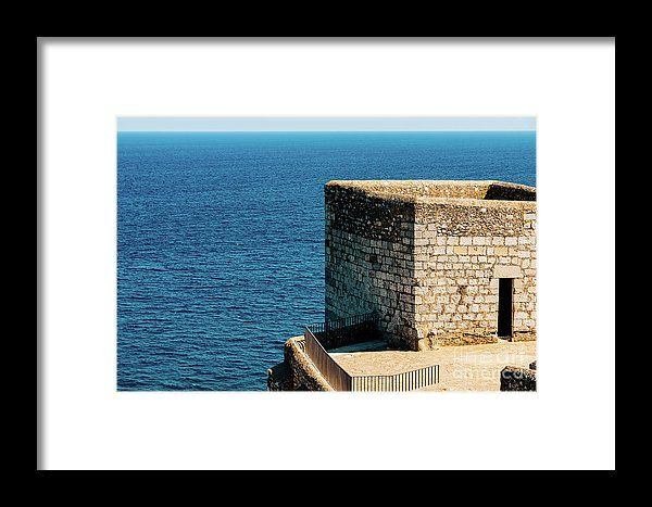 Old Castle Stone Wall And Tower With Ocean Background Framed Print