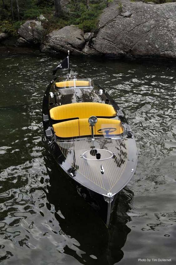 Runabouts & Speedboats   Deep finish wood boat with standout yellow seating